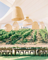 jena donny wedding outdoor reception tables and hanging lanterns