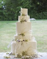 White Wedding Cake with Feather and Flower Cake Topper