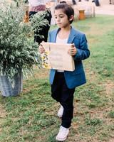 boy holding sign