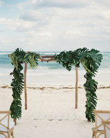 beach altar logs and draped greenery