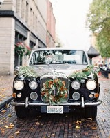 Fall Wreath and greenery draping black car