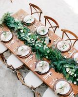 tropical wedding table setting palm leaves