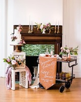 wedding bar cart featuring signature drink sign