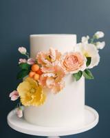 white fondant wedding cake with flowers