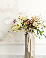 yellow and magenta floral bouquet with greenery