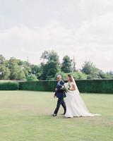father of the bride walking bride toward wedding ceremony aisle