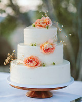 ashley basil wedding buttercream cake with coral flowers