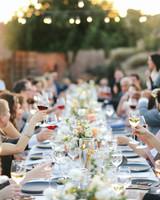 ashley basil wedding reception guests eating at long table