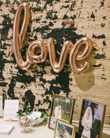 gold love balloon welcome table