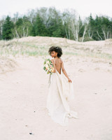 bride wearing backless wedding dress on the beach