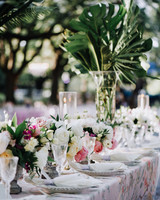 cathleen and winston wedding outdoor reception table decorations pink and white roses and palm fronds