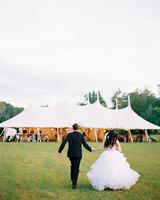 dani jackson wedding couple running toward tent