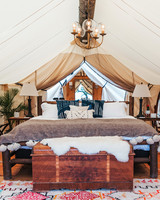 dude ranch honeymoon collective retreats tent bed interior
