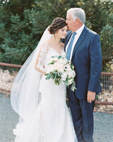 father of the bride wearing a navy blue suit with a blue printed tie