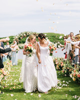 brides walk down wedding recessional aisle