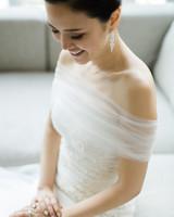 bride wearing long earrings