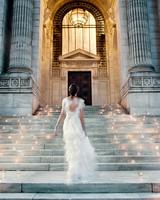 bride walking up lighted stairway