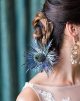 low chignon wedding day hair with blue thistle accent