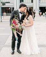 stephanie tim wedding couple kissing outside