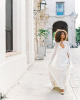 bride wearing wedding dress with cape