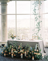 sweetheart table with tulle window backdrop