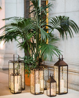 twinkle lights in lanterns around palm tree