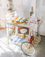 pastel-themed wedding bar cart featuring desserts