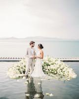 wedding ground all white floral arch underwater