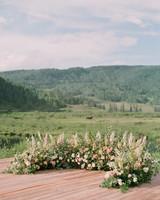 wedding ground flora arch outdoor venue