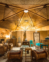 air bnb wedding venue rustic hut with taxidermy and whicker furniture