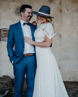 bride wearing blue hat with white ribbon