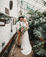 elopement outfit inspiration couple standing in green house