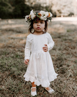 flower girl wearing eyelet lace dress