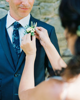 kelly pete wedding bride pinning boutonniere