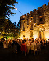 warmly-lit outdoor wedding reception