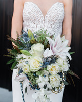 bouquet with trumpet lily thistle and garden roses