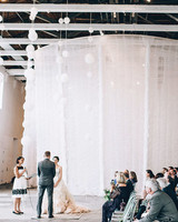 White Hanging Art Installation at a Modern Ceremony