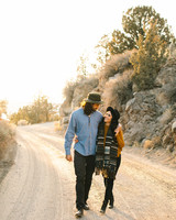 couple walking in desert outdoor engagement photos