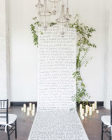 wedding ceremony scroll vows greenery candles