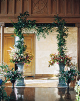 Flower Arrangement And Greenery Garland Wedding Arch