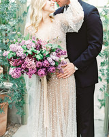 single flower wedding bouquet lilacs held by bride in sheer sparkly dress