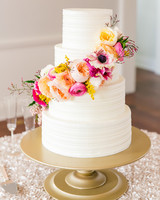 wedding cake with bright flowers