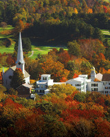 idyllic vermont town surrounded by fall foliage