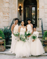 bridesmaids and bride in white