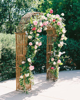 woven rattan wedding decor ceremony arch decorated with roses