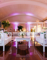 after party decor white lounge seating with purple lighting