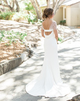 A Bride with a Sheath Wedding Dress featuring an Open Back
