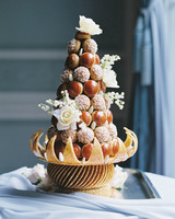 wedding croquembouche dessert adorned with white roses