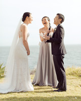 Officiant Laughing with Couple
