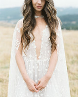 bride wearing plunging neckline gown with sequined stars